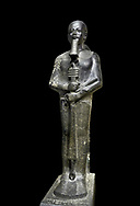 Ancient Egyptian statue of the god Ptah, granodiorite, New Kingdom, 18th Dynasty, (1390-1353 BC)Karnak. Egyptian Museum, Turin. black background,<br /> <br /> The statue of the god Ptah is in the likeness of the reigning king Amenhotep III with a youthful almost feminine face, full cheeks, large smiling mouth and fleshy lips. The large almond shaped eyes are characteristic of the period as is the outline of the lips, Drovetti collection. Cat 86 .<br /> <br /> If you prefer to buy from our ALAMY PHOTO LIBRARY  Collection visit : https://www.alamy.com/portfolio/paul-williams-funkystock/ancient-egyptian-art-artefacts.html  . Type -   Turin   - into the LOWER SEARCH WITHIN GALLERY box. Refine search by adding background colour, subject etc<br /> <br /> Visit our ANCIENT WORLD PHOTO COLLECTIONS for more photos to download or buy as wall art prints https://funkystock.photoshelter.com/gallery-collection/Ancient-World-Art-Antiquities-Historic-Sites-Pictures-Images-of/C00006u26yqSkDOM