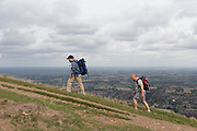 Hill walkers climb The Beacon, on 15th September 2018, in Malvern, Worcestershire, England UK. Worcestershire Beacon, also popularly known as Worcester Beacon, or locally simply as The Beacon, is a hill whose summit at 425 metres (1,394 ft)[1] is the highest point of the range of Malvern Hills that runs about 13 kilometres (8.1 mi) north-south along the Herefordshire-Worcestershire border, although Worcestershire Beacon itself lies entirely within Worcestershire.