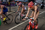 USA's Gwen Jorgensen (right) in the cycling phase of the womens' Triathlon held in Hyde Park during the London 2012 Olympics. The race was eventually won in a photo finish by the Swiss Nicola Spirig, Lisa Norden (Silver) and Australia's Erin Densham (Bronze)