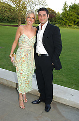 CEM & CAROLINE HABIB at 'Horticouture' a charity fashion show to raise funds for Tommy's, the baby charity and The Royal Botanic Gardens, Kew held at Kew on 12th May 2005.<br /><br />NON EXCLUSIVE - WORLD RIGHTS