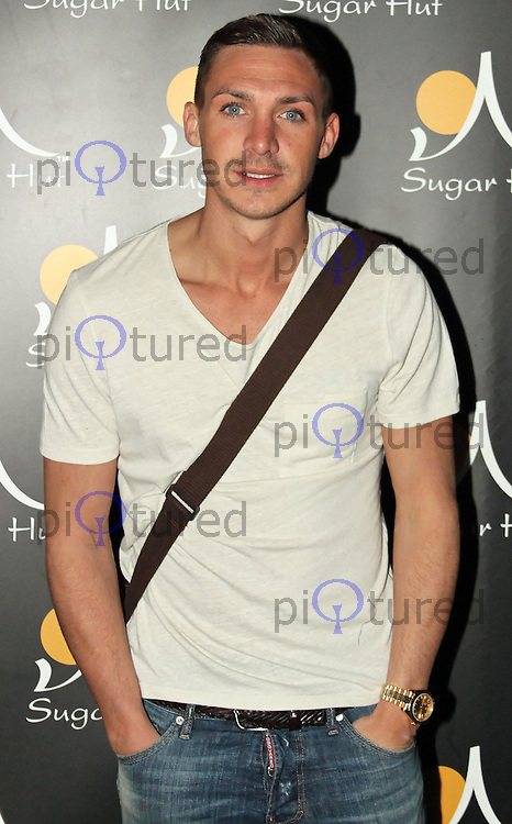 Former TOWIE and CBB star Kirk Norcross poses at the Sugar Hut, London, UK. April 20, 2012. (Photo by Brett Cove)