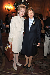 Left to right, GUILDA NAVIDI-WALKER and BARONESS NICHOLSON OF WINTERBOURNE at a fashion show and lunch in aid of  AMAR International Charitable Foundation held at The Dorchester, Park Lane, London W1 on 9th October 2008.