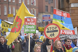 November 12, 2016 - Manchester, England, United Kingdom - Light shines on a placard with an anti-fracking message during an anti-fracking demonstration on November 12, 2016 in Manchester, England. Hydraulic Fracturing is expected to take place in various locations around England, whilst the Scottish and Welsh Governments has introduced moratoriums on the gas extraction method. Hydraulic Fracturing is expected to take place in various locations around England, whilst the Northern Irish, Scottish and Welsh Governments has introduced moratoriums on the gas extraction method. Although fracking is a controversial form of energy extraction, due to environmental concerns, fracking is supposed to provide cheaper and more secure energy for the United Kingdom's domestic energy market. (Credit Image: © Jonathan Nicholson/NurPhoto via ZUMA Press)