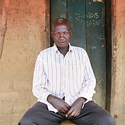 CAPTION: Peter used to lead a reckless sexual life, putting his wife at risk of contracting HIV/AIDS. Thanks to the Pentecostal Assemblies of God (PAG), he was able to join a men's group and attend its 'accountability meetings'. The members of the group are now in the process of setting up a revolving fund so that they can help one another. LOCATION: Abrepoli, Kaberamaido District, Uganda. INDIVIDUAL(S) PHOTOGRAPHED: Peter Ongem.