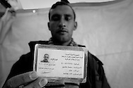 A Syrian army defector from the Alawi sect shows his military ID in a tent in Yayladagi 2 refugee camp, Hatay, Turkey. 15th March 2012, one year after the start of the revolution in syria started. There are approximately more than 15000 Syrian refugees currently in Turkey, with more than 1000 more having made the crossing in the past week. ENN Photo/Bradley Secker