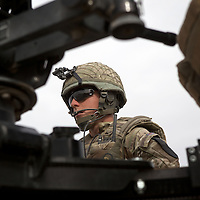 Captain Frank Reeves coordinates his soldiers of 16 Air Assault Bde's elite BRF (Brigade Reconnaissance Force) as they move from compound to compound searching for weapons and explosives as part of an operation in the Western Dasht, Helmand Province, Southern Afghanistan on the 18th of March 2011.