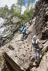 Group of climbers on rock via ferrata towards Lehner Waterfall, Otztal, Tyrol, Austria