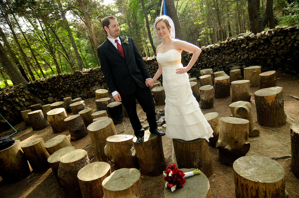 A bride and groom stand on the stumps at the Essex Conference and Retreat Center, Essex, MA.