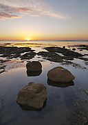 Sunrise from the beach at Boggle Hole, North York Moors
