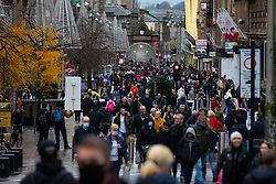 Glasgow, Scotland, UK. 20 November 2020. On the day when the severest level 4 lockdown will be imposed at 6pm, shoppers are out on the streets of Glasgow doing last minute Christmas shopping before the shops close for 3 weeks. Pictured; Crowds of shoppers on Buchanan Street. Iain Masterton/Alamy Live News