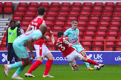 Jake Bidwell of Swansea City is tackled by Tobias Figueiredo of Nottingham Forest  - Mandatory by-line: Nick Browning/JMP - 29/11/2020 - FOOTBALL - The City Ground - Nottingham, England - Nottingham Forest v Swansea City - Sky Bet Championship