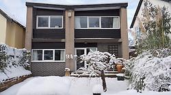 Modernist architect build 1960's detached house Nottingham in snow