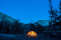 Man hiking, climbing, backpacking, fly fishing and camping in the back country of Wyoming's Wind River Mountain range.