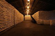 Warehouse full of sugar sacks at the Belize Sugar Industries Factory, facility that processes all of the BSCFA's sugar cane. Belize Sugar Cane Farmers Association (BSCFA). Belize Sugar Industries Factory, Orange Walk, Belize. January 22, 2013.