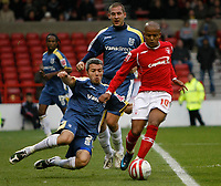Photo: Richard Lane/Richard Lane Photography. Nottingham Forest v Cardiff City. Coca Cola Championship. 24/10/2008. Rob Earnshaw (R) is tackled by Kevin McNaughton (L)