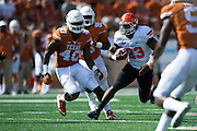 AUSTIN, TX - SEPTEMBER 26:  Rennie Childs #23 of the Oklahoma State Cowboys breaks free against the Texas Longhorns during the 2nd quarter on September 26, 2015 at Darrell K Royal-Texas Memorial Stadium in Austin, Texas.  (Photo by Cooper Neill/Getty Images) *** Local Caption *** Rennie Childs