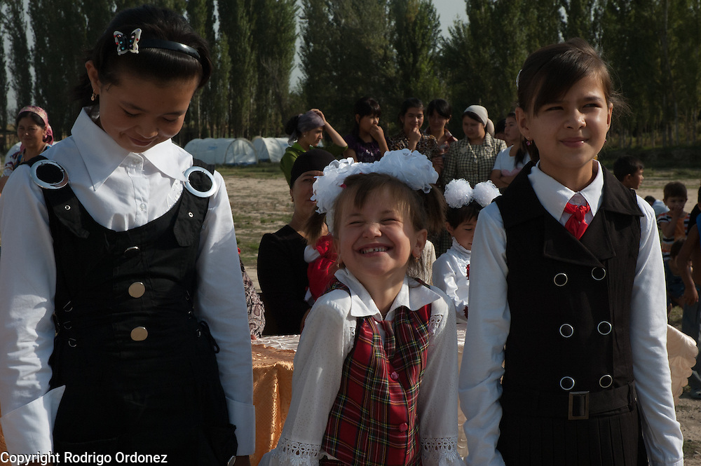 A girl laughs during the ceremony to mark the 'first bell', or first day of school, at School 124 in Osh, Kyrgyzstan.