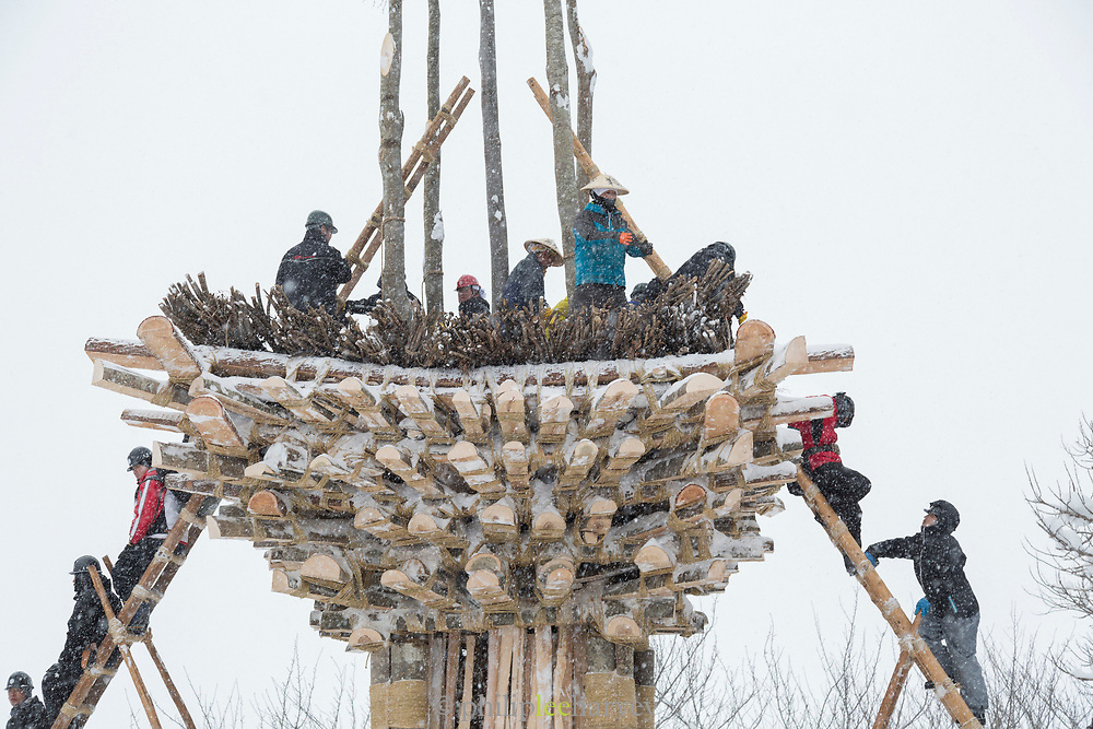 Group of people working on building wooden construction, Nozawaonsen, Japan