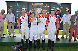 The victorious England team winners of the St.Regis International Polo Cup at the St.Regis International Polo Cup at Cowdray Park, Midhurst, West Sussex on 17th May 2014.