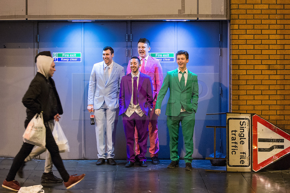 © Licensed to London News Pictures . 01/01/2015 . Manchester , UK . Four men in matching coloured suits stand in a doorway on Withy Grove . Revellers usher in the New Year on a night out in Manchester City Centre .  Photo credit : Joel Goodman/LNP