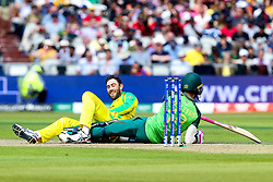 Glenn Maxwell of Australia falls over Faf du Plessis of South Africa - Mandatory by-line: Robbie Stephenson/JMP - 06/07/2019 - CRICKET - Old Trafford - Manchester, England - Australia v South Africa - ICC Cricket World Cup 2019 - Group Stage