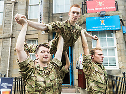 Brigadier Gary Deakin CBE welcomes performers to the Army reserve centre at Hepburn House for the opening of the Army's first ever Edinburgh Festival Fringe venue.<br /> <br /> Pictured: Performers from the Rosie Kay Dance Company production of 5 Soldiers