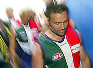 """PERTH, AUSTRALIA - APRIL 23:  Peter Bell of the Dockers leaves the ground after winning the round five """"Len Hall Tribute"""" AFL match between the Fremantle Dockers and the Carlton Blues at Subiaco Oval on April 23, 2005 in Perth, Australia.  (Photo by Paul Kane/Getty Images) *** Local Caption *** Peter Bell"""