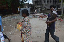 August 27, 2017 - Kolkata, West Bengal, India - A heart breaking astonishing situation - little child with parents and other family members,Father  holding a huge oxygen cylinder and Mother holding the baby with the pipe inside nostrils of the little child rushing from one to the other department of the hospital for treatment without any support at the heritage hospital, Medical College,Kolkata on 27.8.2017  (Credit Image: © Sandip Saha/Pacific Press via ZUMA Wire)