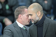 Josep Guardiola (Manager)(Manchester City) listens to what Brendan Rodgers (Manager)(Celtic) is saying as they meet on the touchline before the Champions League match between Manchester City and Celtic at the Etihad Stadium, Manchester, England on 6 December 2016. Photo by Mark P Doherty.