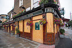 © Licensed to London News Pictures. 04/07/2020. London, UK. The Elephant's Head pub in Camden, North London, remains closed and boarded up, despite Pubs, bars, cafes and restaurants being allowed to fully open for the first time since lockdown. Photo credit: Ben Cawthra/LNP