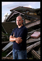 27 August 2006 - New Orleans - Louisiana. Ryan Parry. The (London) Daily Mirror's New York bureau chief revisits the city to witness the destruction that remains one year after hurricane Katrina. Parry stands in the still devastated lower 9th ward.