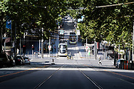 An almost empty Bourke St on the first day of a five day snap lockdown in Victoria due to COVID-19 outbreak originating at The Holiday Inn. The entire state is returning to harsh stage-four lockdowns until Wednesday at 11.59pm as health authorities struggle to contain the Holiday Inn coronavirus outbreak.