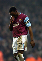 Photo: Olly Greenwood.<br />West Ham United v Portsmouth. The Barclays Premiership. 26/12/2006. West Ham's Nigel Reo Coker looks dejected at the end of the game