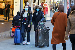 © Licensed to London News Pictures. 29/01/2020. London, UK. Women with suitcases on Oxford Street, in West End are seen wearing a face masks following the outbreak of Coronavirus in Wuhan,  which has killed 132 people and infected more than 6,000. According to the Department of Heath, 97 people have been tested for Coronavirus in the UK and all have been confirmed negative. Photo credit: Dinendra Haria/LNP