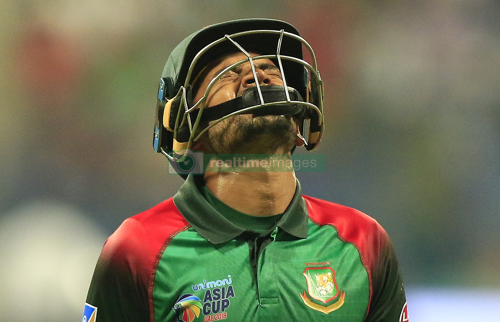 September 26, 2018 - Abu Dhabi, United Arab Emirates - Bangladesh cricketer Mushfiqur Rahim reacts as he walks back following his dismissal on 99 runs during the Asia Cup 2018 cricket match  between Bangladesh and Pakistan at the Sheikh Zayed Stadium,Abu Dhabi, United Arab Emirates on September 26, 2018  (Credit Image: © Tharaka Basnayaka/NurPhoto/ZUMA Press)