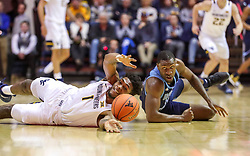Dec 1, 2019; Morgantown, WV, USA; West Virginia Mountaineers forward Derek Culver (1) and Rhode Island Rams forward Cyril Langevine (10) dive for a loose ball during the second half at WVU Coliseum. Mandatory Credit: Ben Queen-USA TODAY Sports