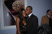 Jamelia and Darren Byfield. The Moet & Chandon Fashion Tribute 2005 to Matthew Williamson,  Old Billingsgate market, London. 16th February 2005. ONE TIME USE ONLY - DO NOT ARCHIVE  © Copyright Photograph by Dafydd Jones 66 Stockwell Park Rd. London SW9 0DA Tel 020 7733 0108 www.dafjones.com