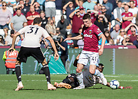 Football - 2018 / 2019 Premier League - West Ham United vs. Manchester United<br /> <br /> Paul Pogba (Manchester United) slides in from behind to make the tackle on Declan Rice (West Ham United) at the London Stadium<br /> <br /> COLORSPORT/DANIEL BEARHAM