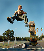 PASCO- ZEPHYRHILLS,FL.-  Justin Hill,13, makes a jump in the air while at the Zephyrhills skate board park. The City of Zephyrhills requires the kids to wear a helmut but the majority of kids do not. (staff/scott iskowitz)