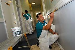 Painters & decorators painting old NHS building Yorkshire UK