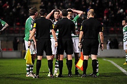 Yeovil Town Jamie McAllister and Yeovil Town Byron Webster leads the protest against the referees decision to end the game as they feel they were on the attack - Photo mandatory by-line: Dougie Allward/JMP - Tel: Mobile: 07966 386802 09/01/2013 - SPORT - FOOTBALL - Matchroom Stadium - London -  Leyton Orient v Yeovil Town - Johnstone's Paint Trophy Southern area semi-final.