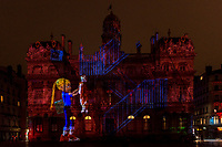 Enoha fait son cinema - Place des Terreaux, Lyon 1<br /> Artist: Nathanaelle Picot<br /> TheFestival of Lights inLyon,Franceexpresses gratitude towardMary, mother of Jesusaround December 8th of each year.<br /> This uniquely Lyonnaise tradition dictates that every house place candles along the outsides of all the windows to produce a spectacular effect throughout the streets. The festival includes other activities based on light and usually lasts four days, with the peak of activity occurring on the 8th. <br /> The two main focal points of activity are typically theBasilica of Fourvierewhich is lit up in different colours, and thePlace des Terreaux, which hosts a different light show each year.<br /> Spared from plague<br /> The origins of the festival date to 1643 when Lyon was struck byplague. <br /> On September 8,1643 the municipal councillors promised to pay tribute to Mary if the town was spared. Ever since, a solemn procession makes its way to the Basilica of Fourviere on 8 December (the feast of theImmaculate Conception) to light candles and give offerings in the name of Mary. <br /> In part, the event thus commemorates the day Lyon was consecrated to the Virgin Mary.