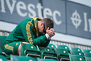 A member of the South African staff watches from the main stand during their game against Italy in the Investec Hockey World League Semi Final 2013, the Quintin Hogg Memorial Sports Ground, University of Westminster, London, UK on 27 June 2013. Photo: Simon Parker