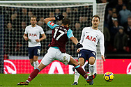 Christian Eriksen of Tottenham Hotspur (R) avoids a challenge from Javier Hernandez of West Ham United (L). Premier league match, Tottenham Hotspur v West Ham United at Wembley Stadium in London on Thursday  4th January 2018.<br /> pic by Steffan Bowen, Andrew Orchard sports photography.