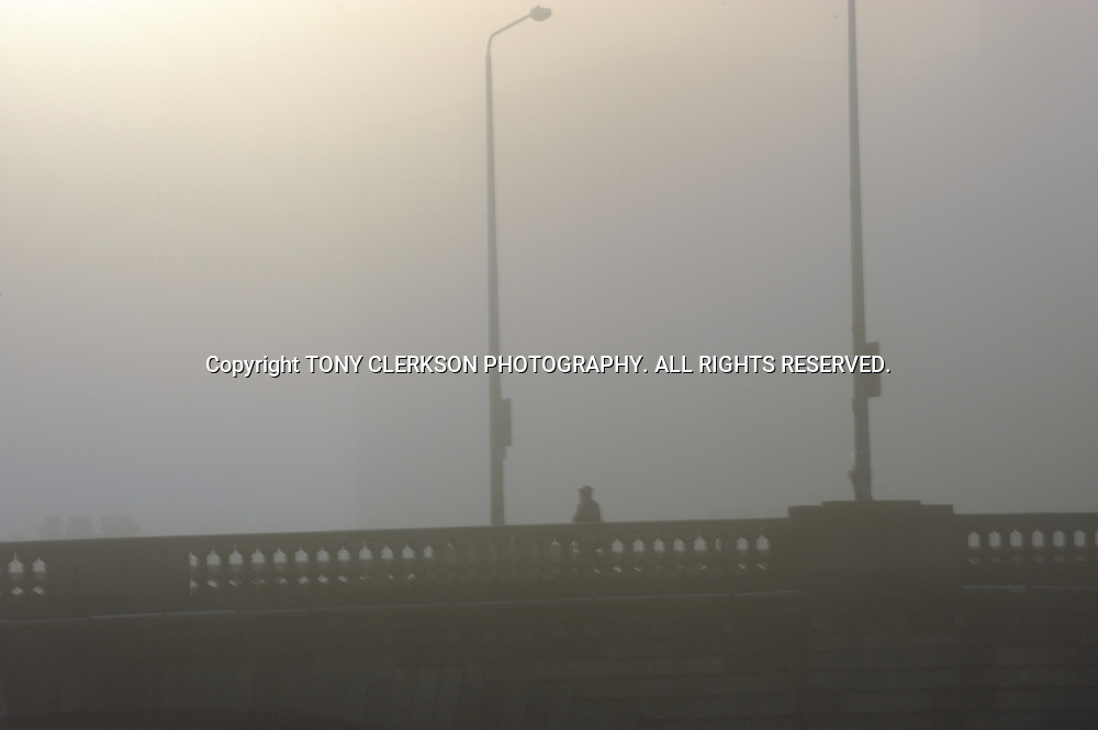Heavy fog envelops Glasgow's River Clyde on a freezing morning