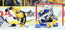 May 2, 2017 - Nashville, TN, USA - The Nashville Predators' Harry Zolnierczyk (26) tries to shoot as he is tripped bythe  St. Louis Blues' Magnus Paajarvi in the second period during Game 4 of the Western Conference semifinals on Tuesday, May 2, 2017, at the Bridgestone Arena in Nashville, Tenn. Defending on the play is Blues goaltender Jake Allen. (Credit Image: © Chris Lee/TNS via ZUMA Wire)