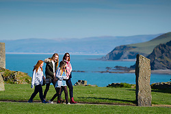 © London news pictures. 25/03/2017. Aberystwyth, UK.<br /> A  family group out walking on a day of glorious sunshine and clear blue skies in Aberystwyth on the west wales coast, with temperatures expected to reach 18 or 19∫c by the afternoon. Sheltered from the cooling effects of an easterly wind, West Wales is expected to be the warmest pace in the UK today (Sat). Photo credit: Keith Morris/LNP