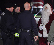 Town of Wallkill, New York  - Santa talks to Town of Wallkill police officers after the Holiday Parade and Tree Lighting in front of Town Hall on Saturday, Nov. 26, 2012.