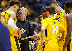 Feb 18, 2019; Morgantown, WV, USA; West Virginia Mountaineers head coach Bob Huggins talks to his team late in the first half against the Kansas State Wildcats at WVU Coliseum. Mandatory Credit: Ben Queen-USA TODAY Sports