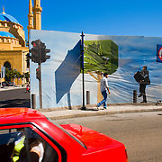 BEIRUT,LEBANON - MAY 2009 : Fence that advertises the new construction of  new luxury residential building  at  Martyr's Square and the Mohammed Al Amin Mosque in background. Beirut. Lebanon. 05/29/2009 ( Photo by Jordi Cami  )